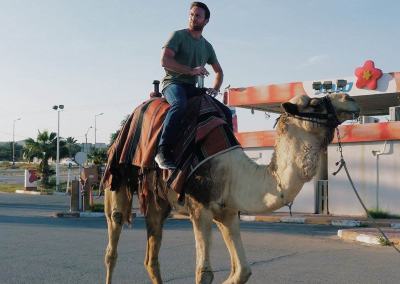 Bobby on a camel in Israel